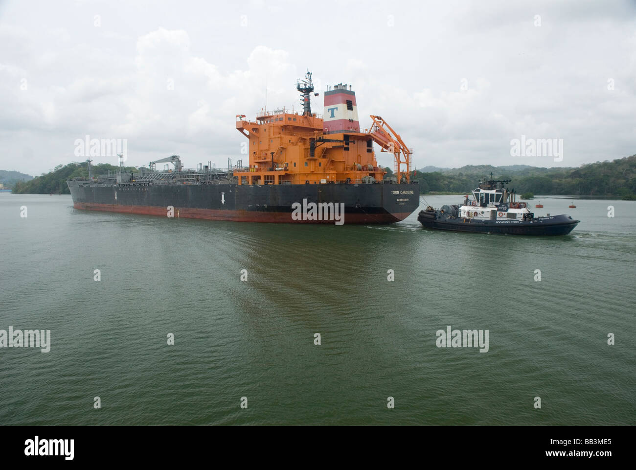 A cargo ship passing through Lake Gatun on the Panama Canal - Stock Image
