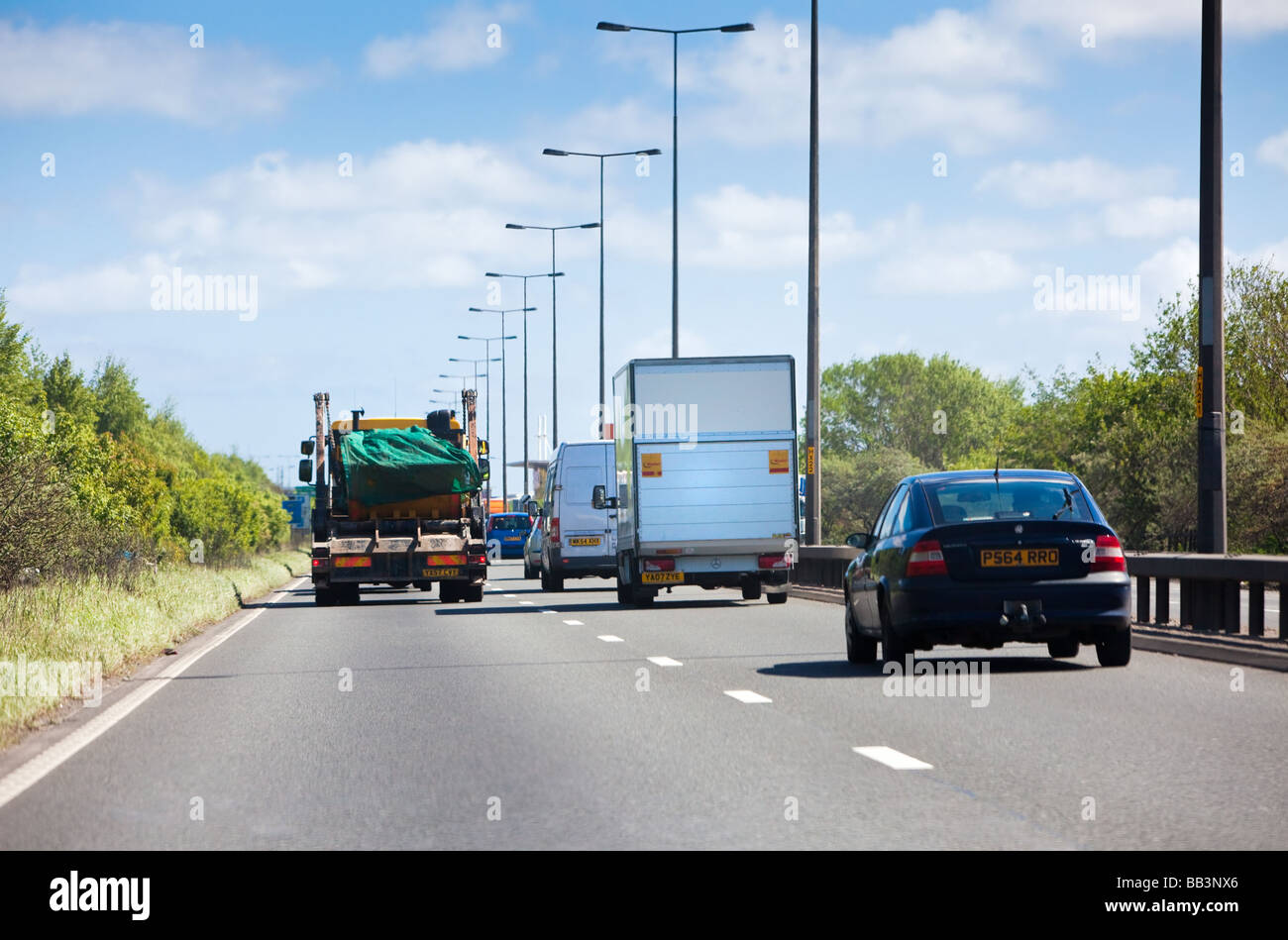 Cars and lorries in heavy traffic driving on the A63 route dual carriageway east towards Hull, England, UK - Stock Image