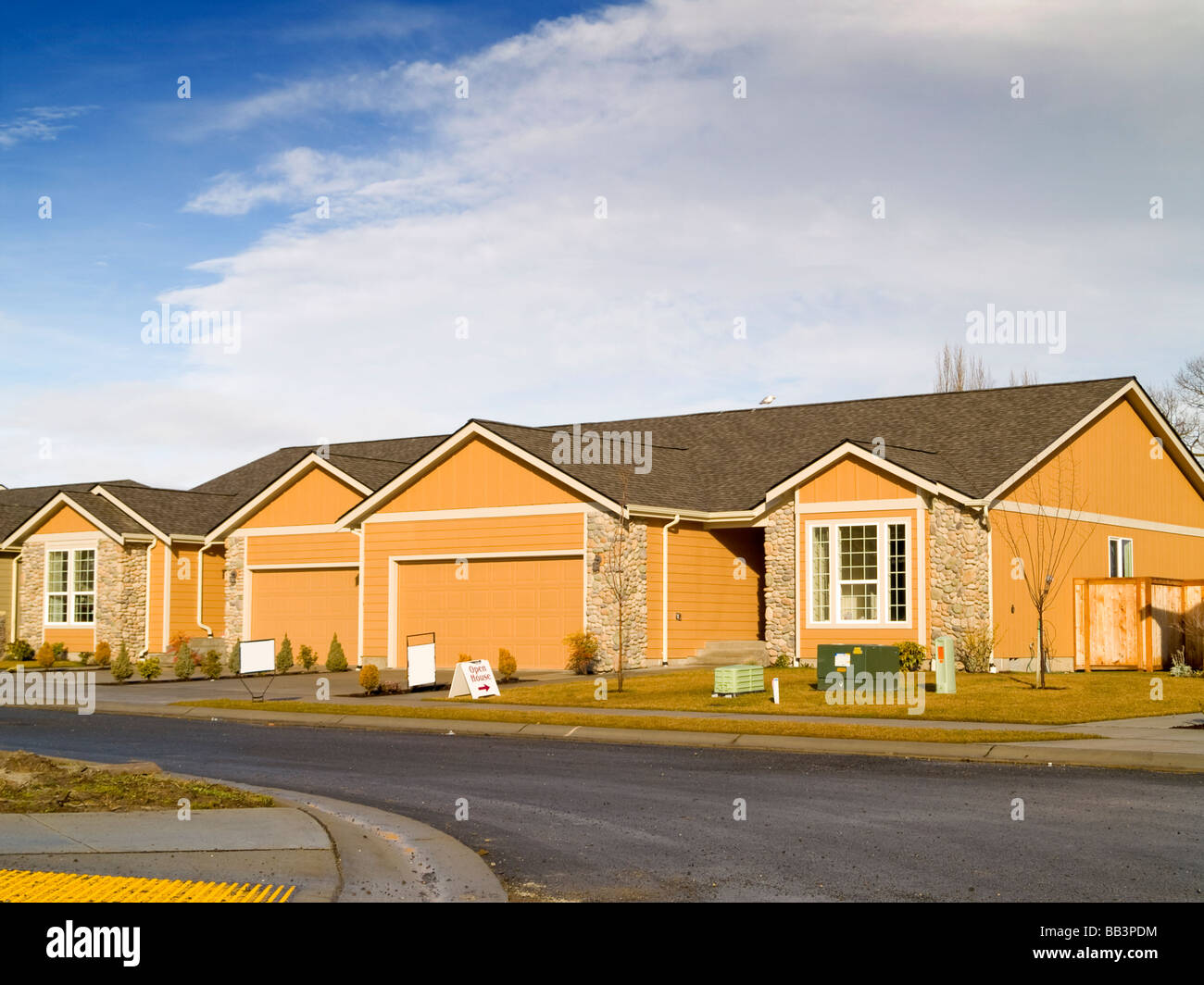 A new house for sale on a warm sunny day - Stock Image