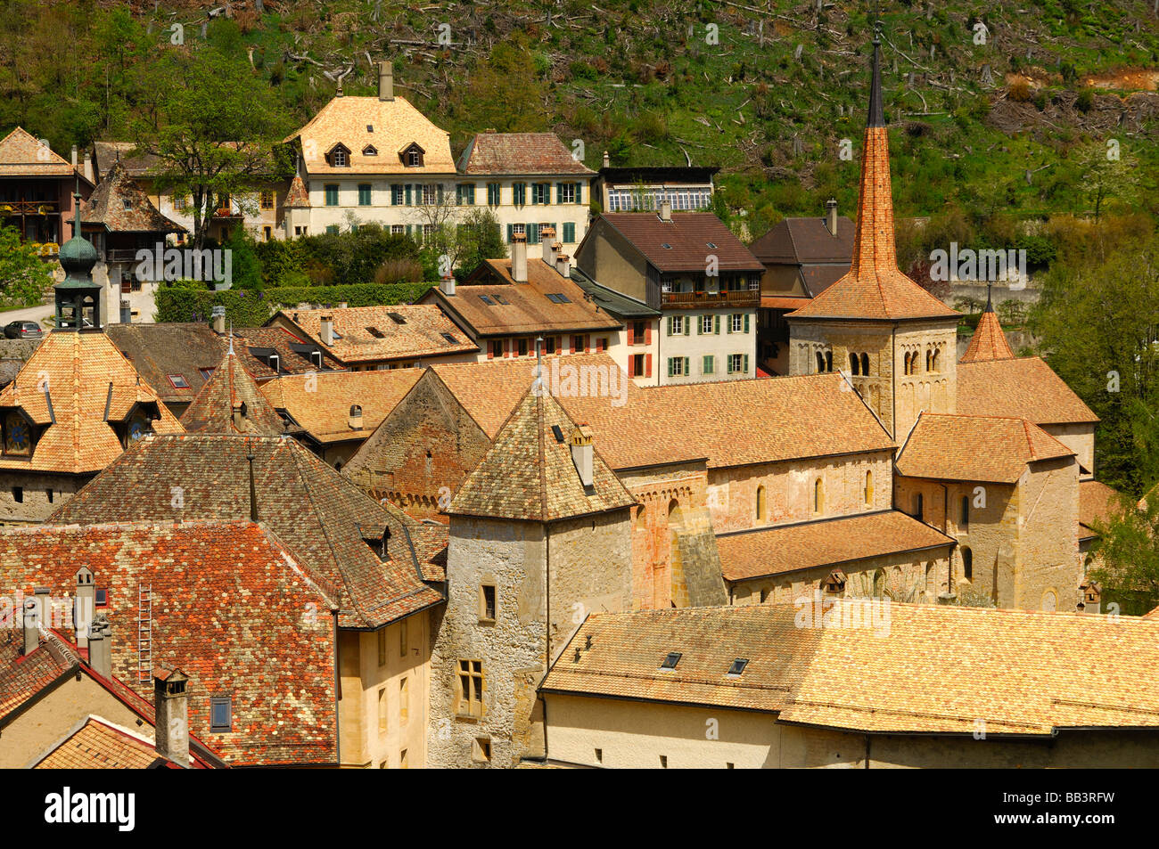 view at the village centre with the collegiate church of the Romanesque abbey, Romainmotier canton of Vaud Switzerland, - Stock Image
