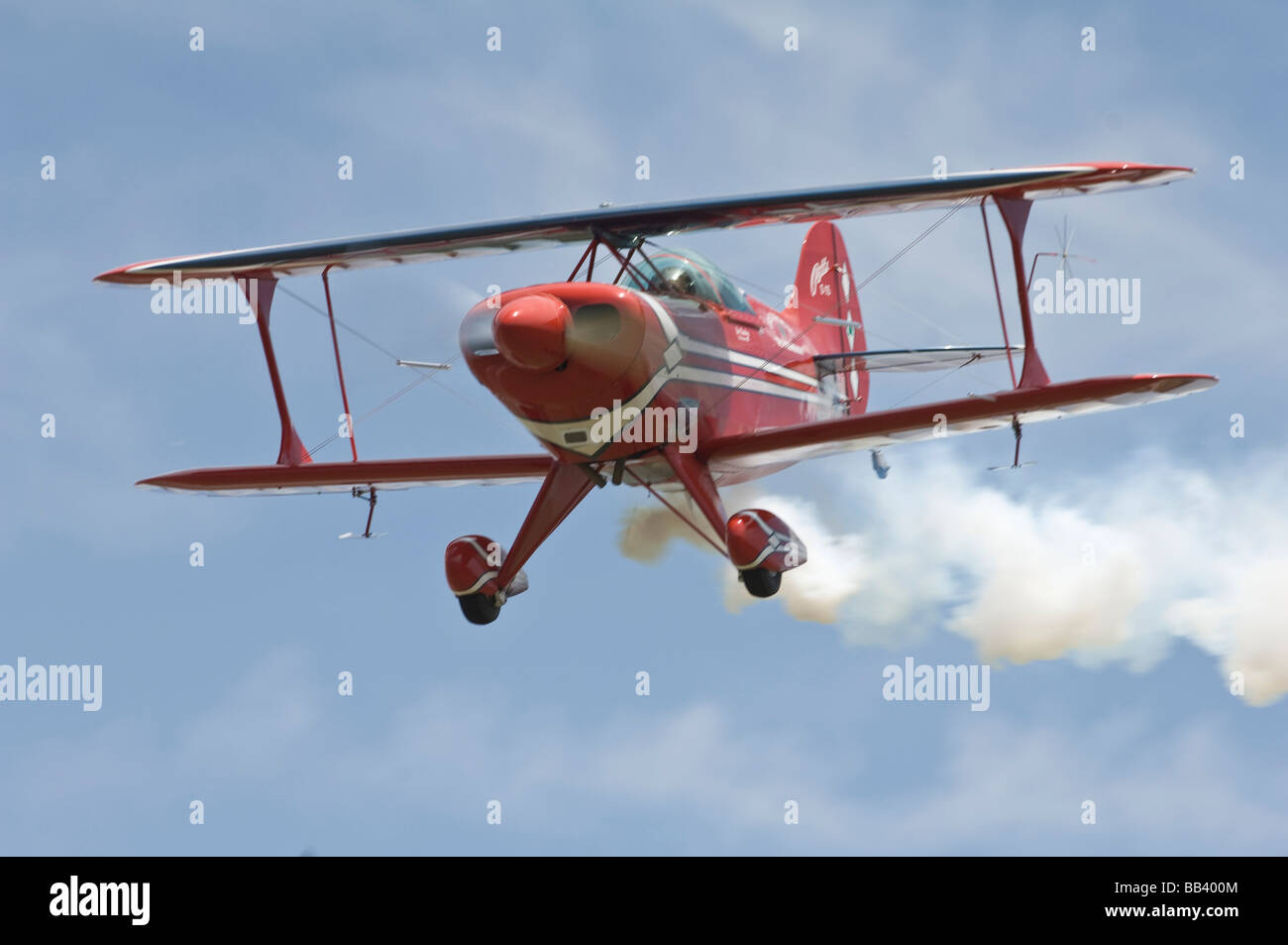 Oracle Challenger II Stunt Biplane trailing with smoke in the air. (Not available as 2017 calendar cover) Stock Photo