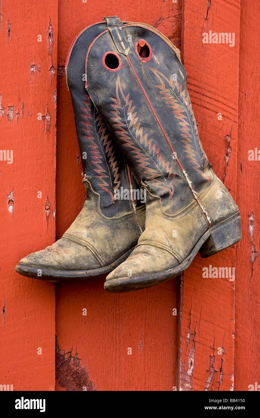 adb444bee92 USA, Oregon, Seneca, Ponderosa Ranch. A pair of worn cowboy boots ...