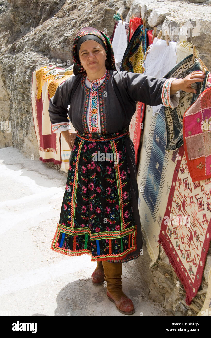 Greek Island Karpathos: Woman with traditional dress in the mountain village Olympos. Stock Photo