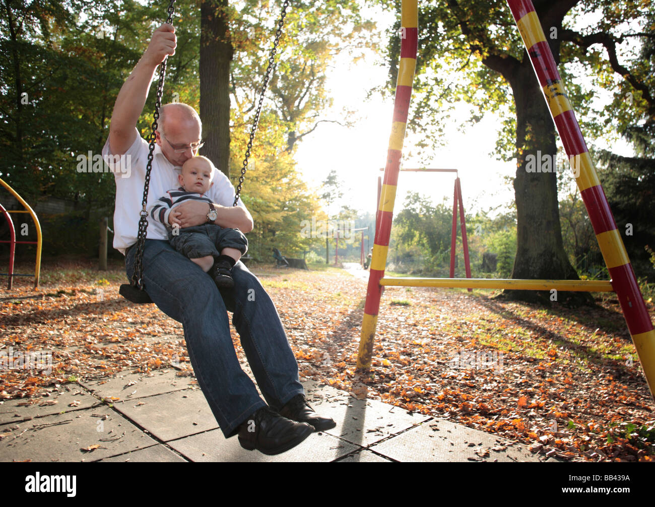 Father and son on a swing - Stock Image
