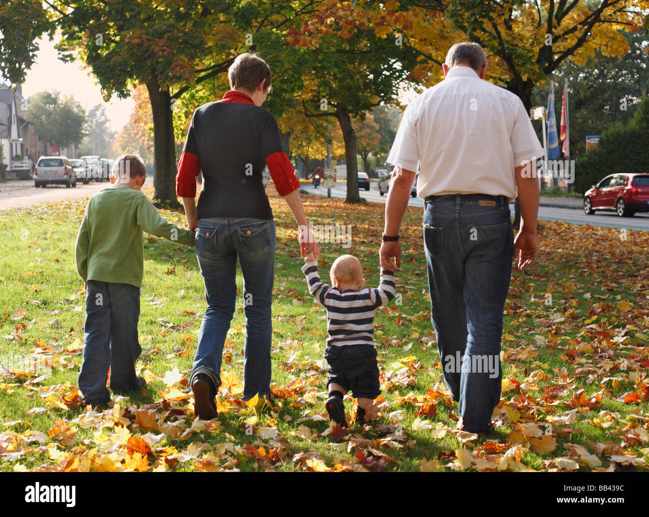 Family with two children in autumn - Stock Image
