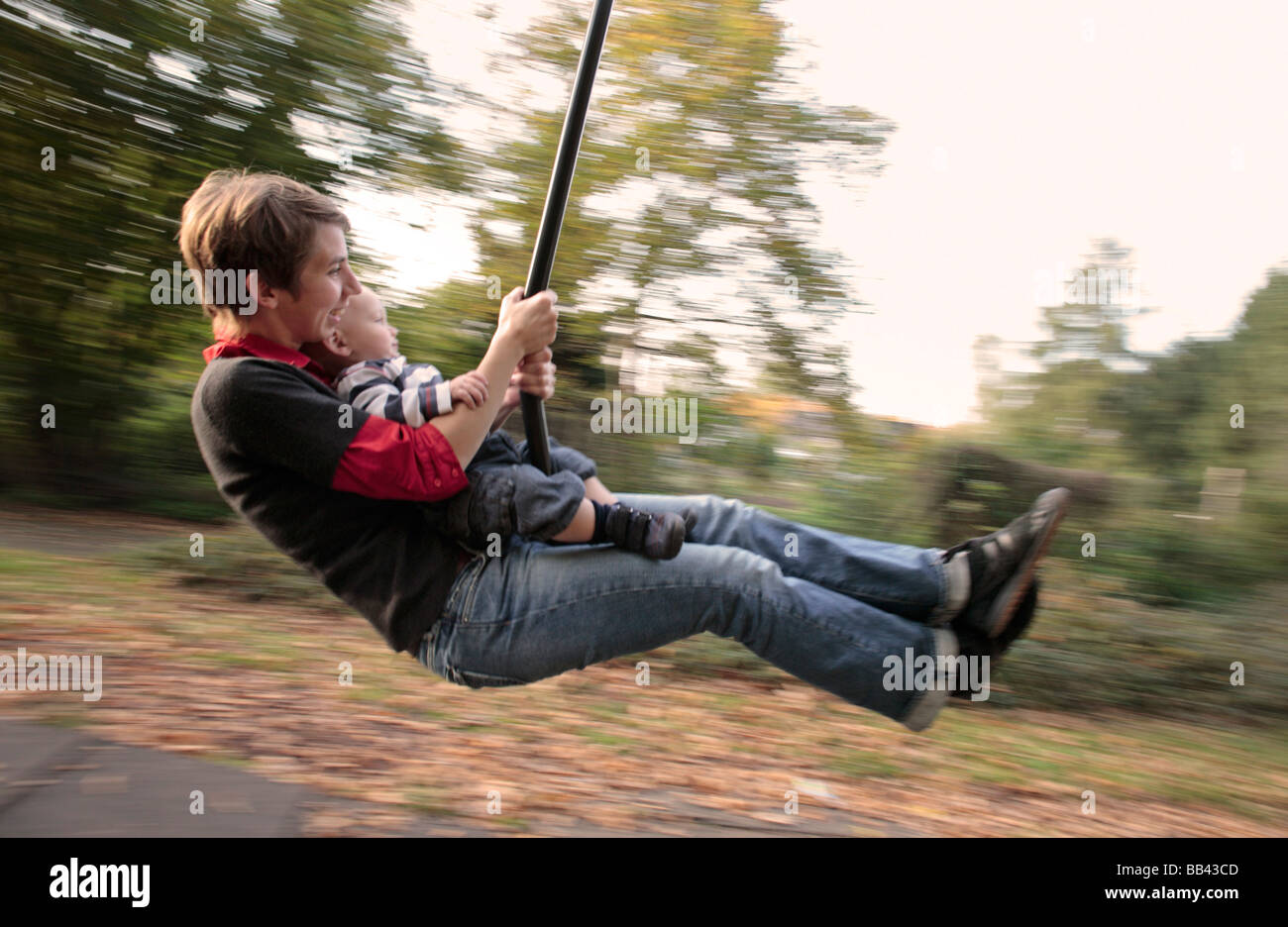 Mother and son on a swing Stock Photo