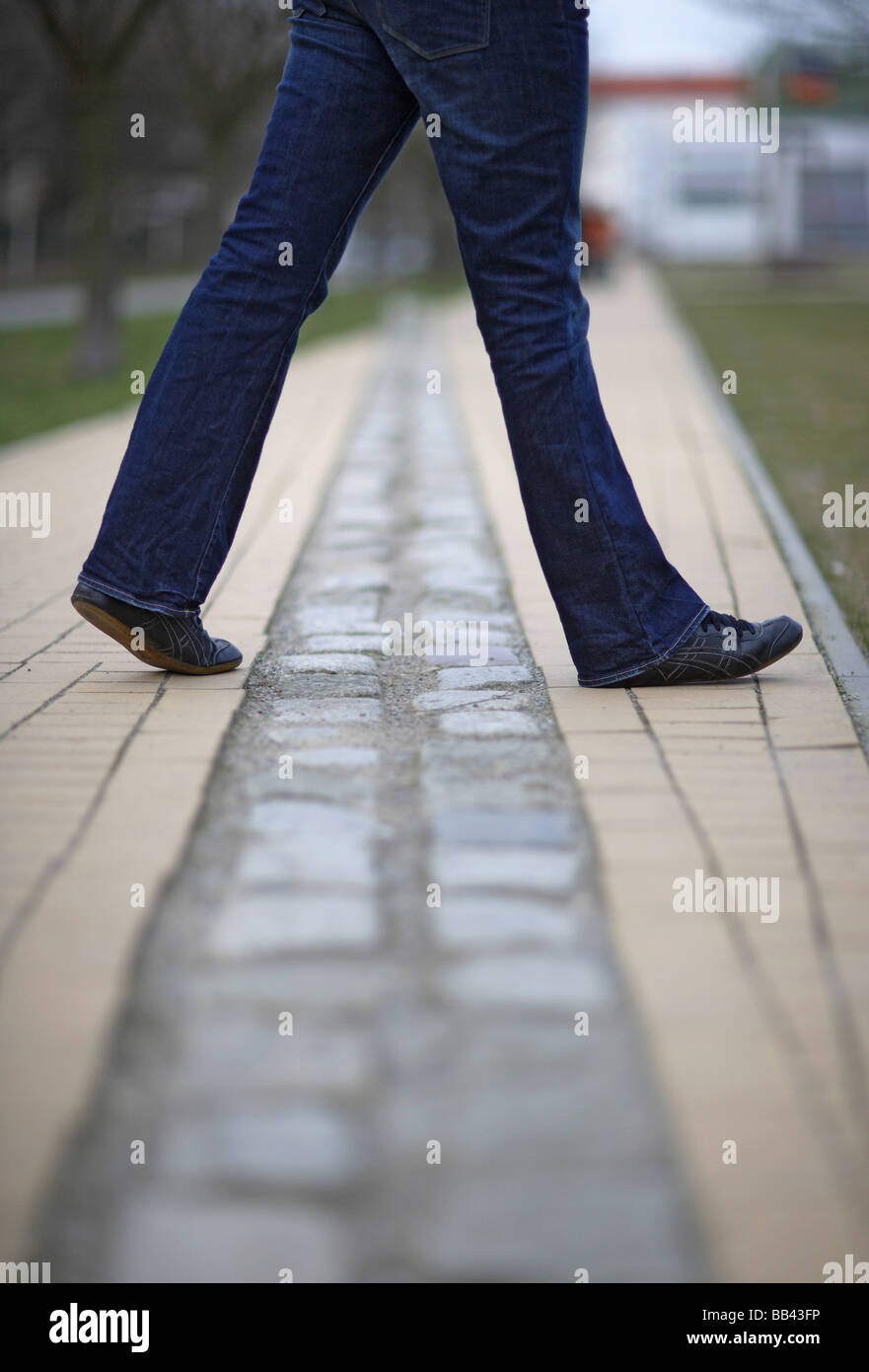 A Person on the former boarder between East and West Berlin - Stock Image