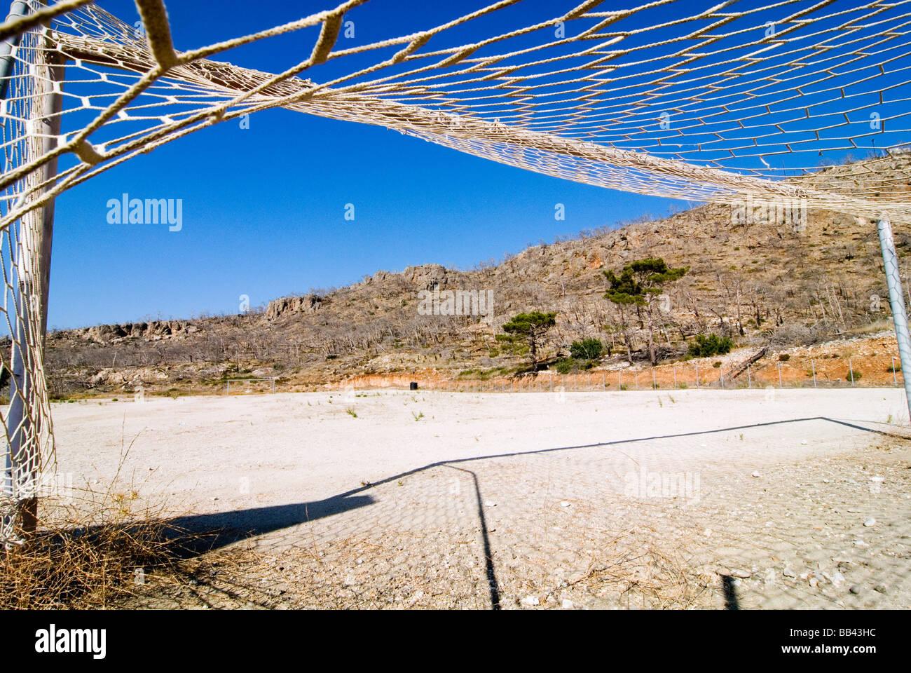 Greek Island Karpathos: Soccerfield in poor landscape. Stock Photo