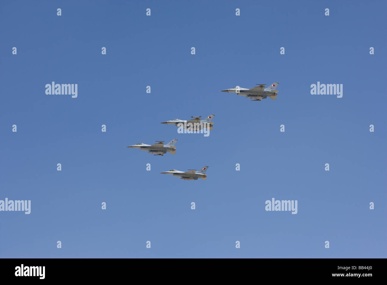 4 Bahrain air force army jets in a blue sky - Stock Image