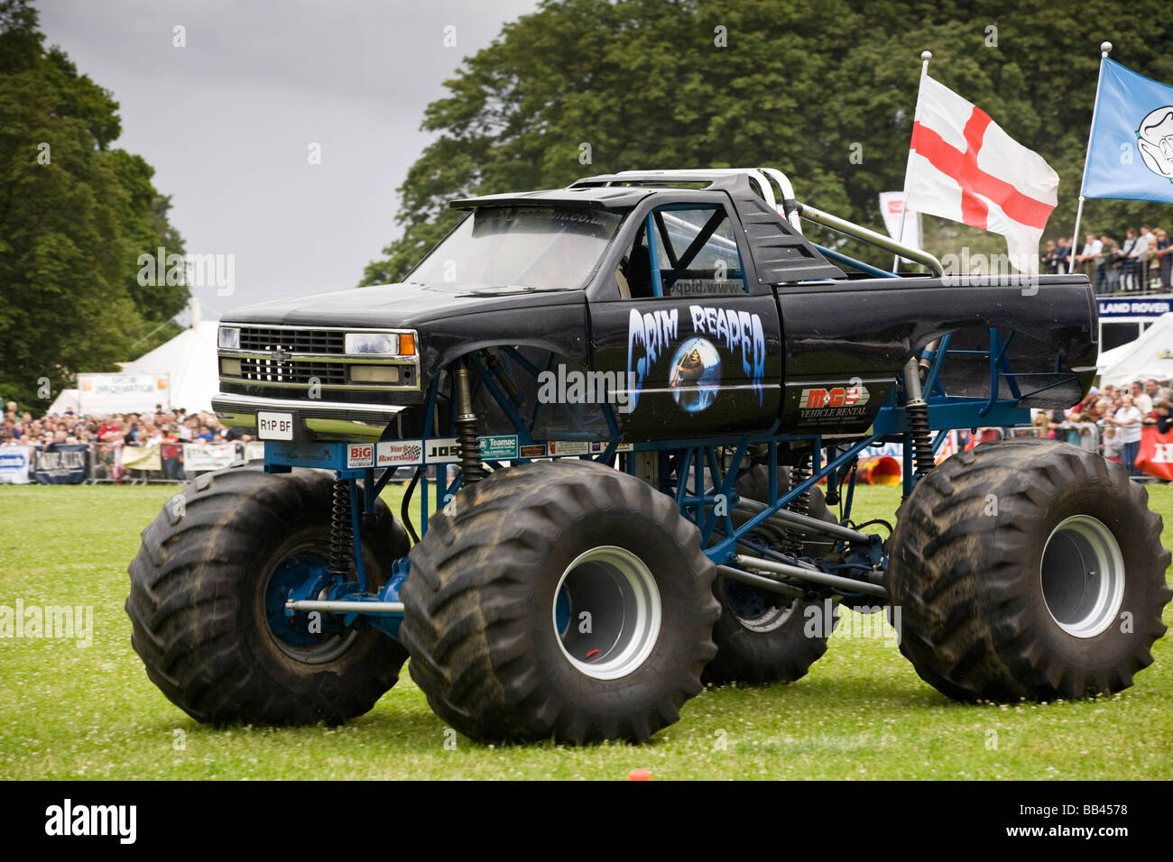 Monster trucks crushing old cars at a farm show, Gloucestershire, UK ...