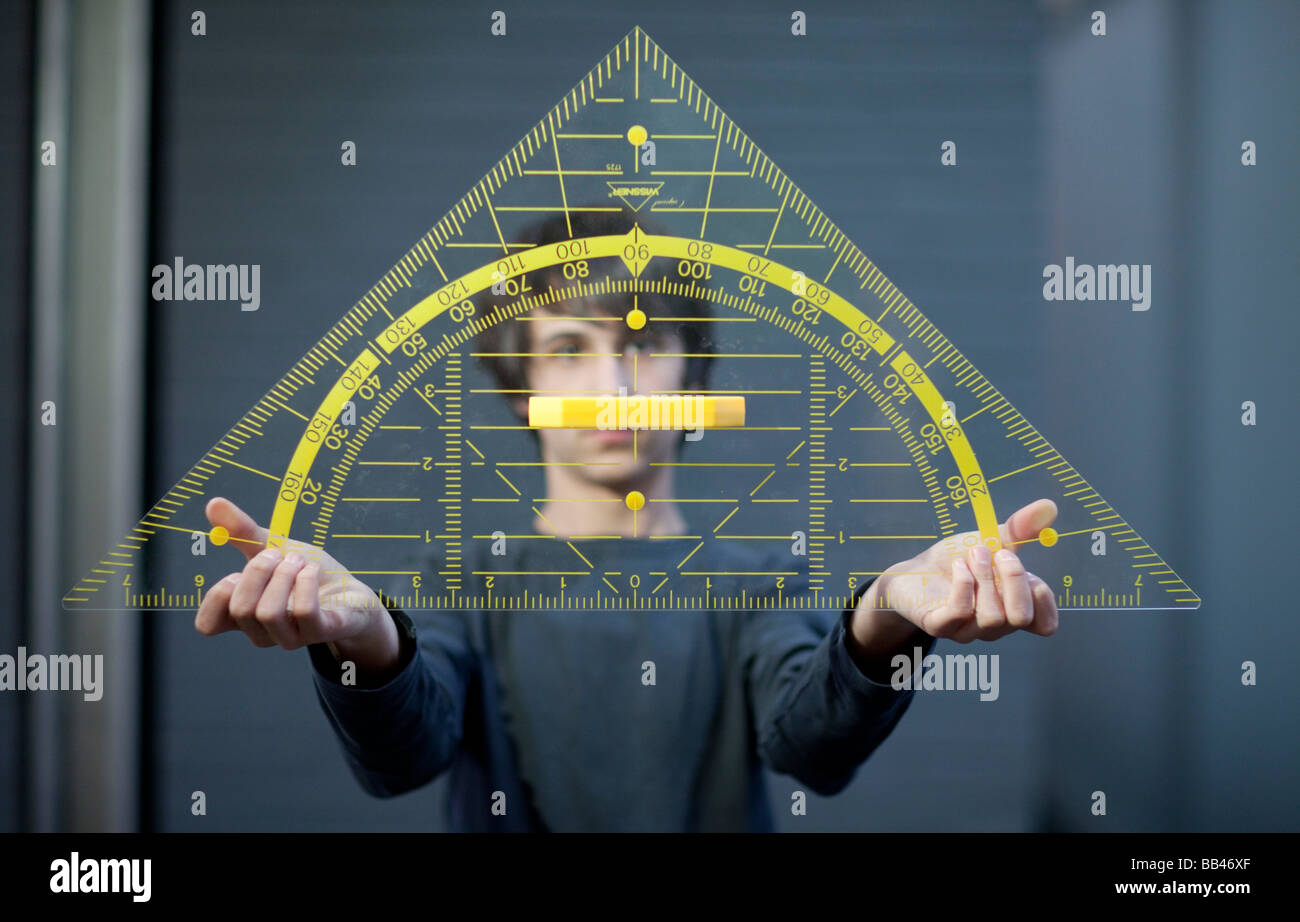 Student holding a big triangle - Stock Image