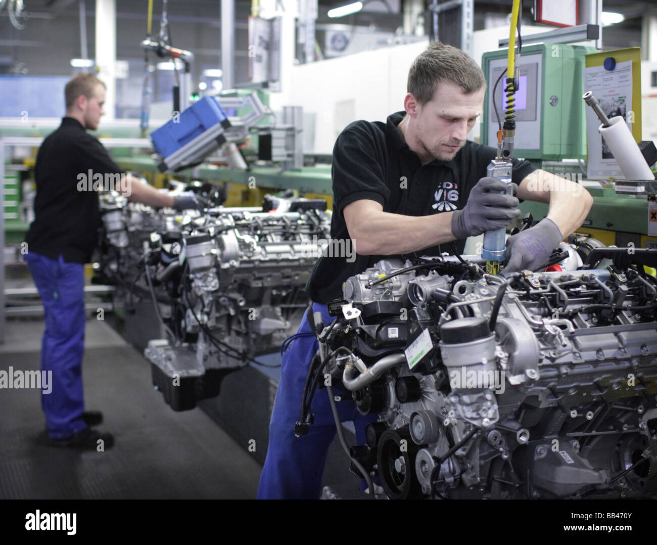 Employees at Mercedes Benz - Stock Image