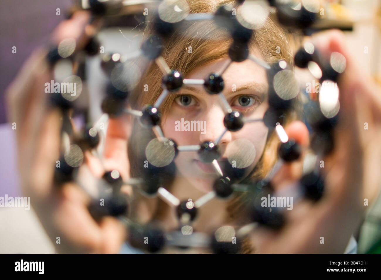 Student with a atom model Stock Photo