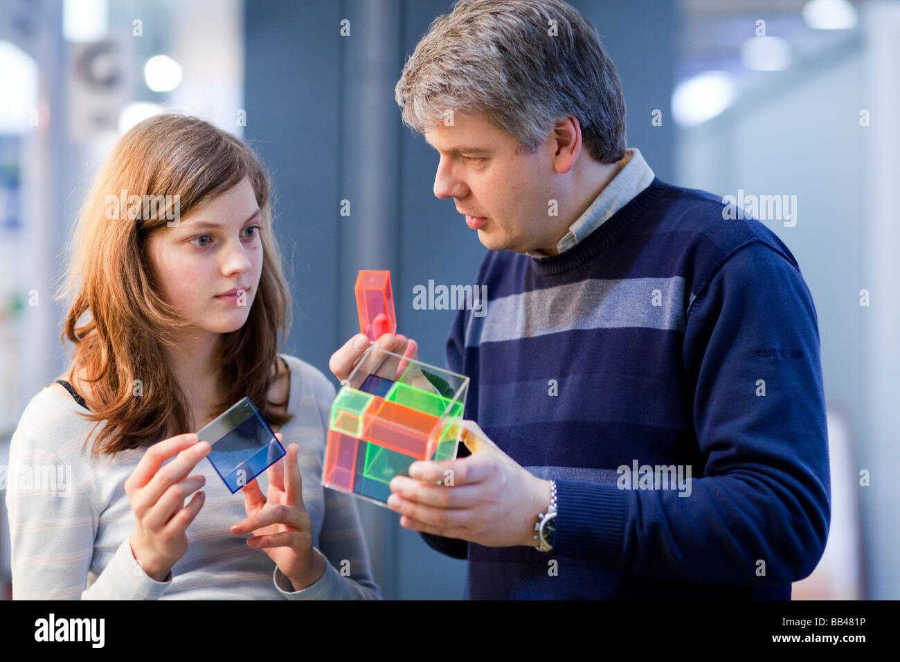 Student and teacher at geometry class - Stock Image