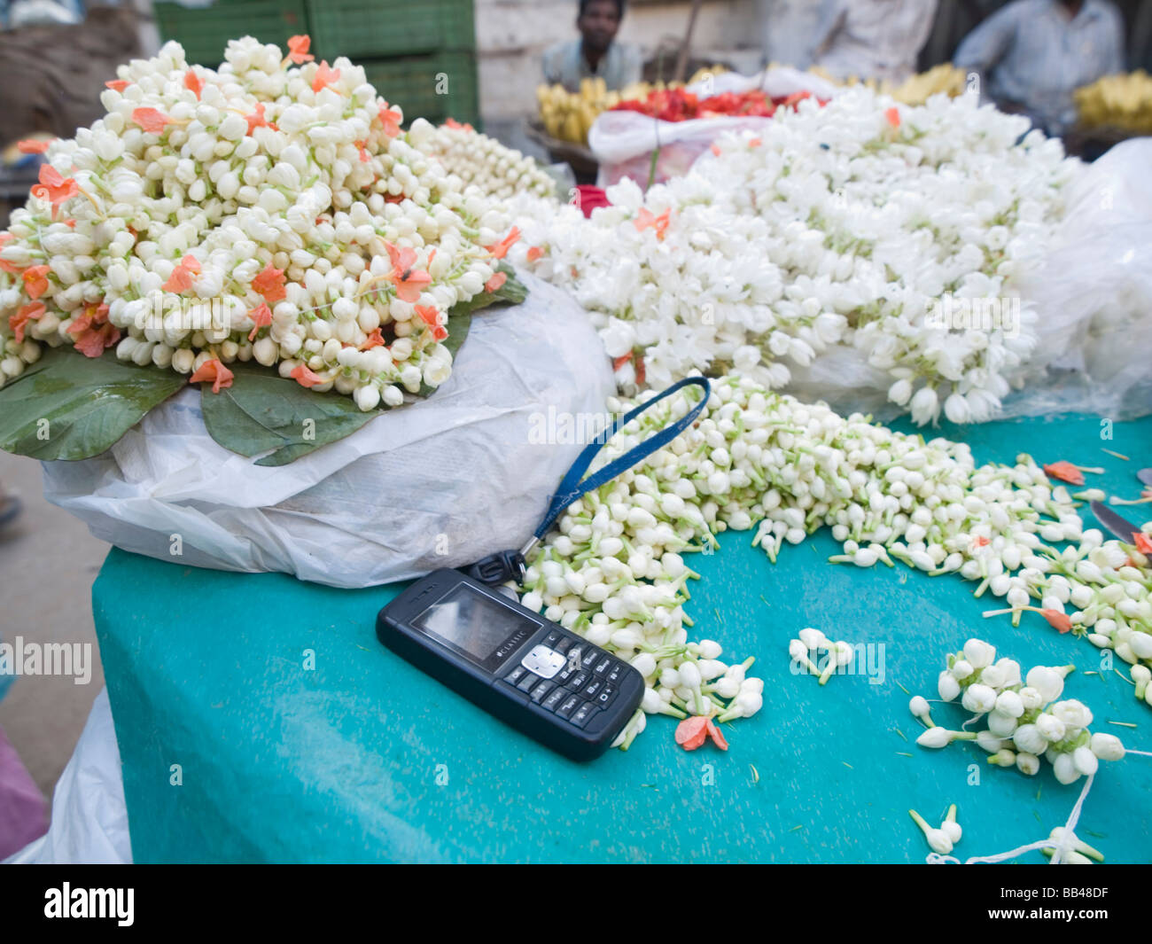 Cell phone used by street level flower seller in Bangalore