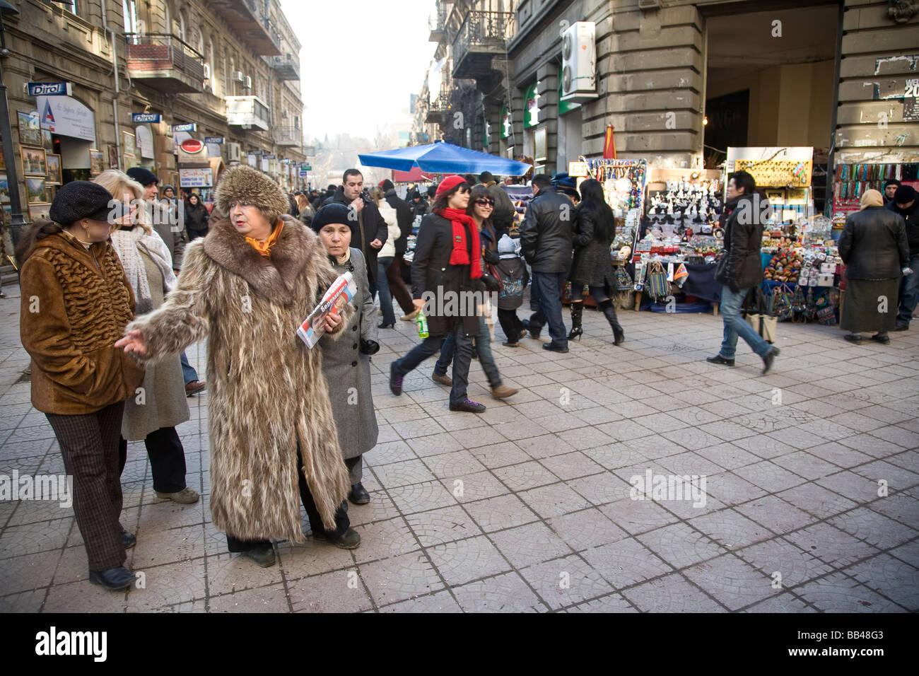 Woman in fur coat shopping in Baku, Azerbaijan - Stock Image
