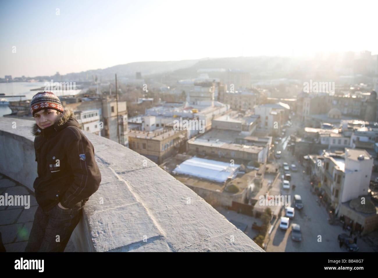 Teenage boy with view over Baku, Azerbaijan Stock Photo