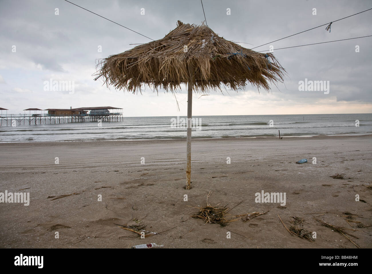 Beach umbrella on the Caspian, Baku, Azerbaijan. - Stock Image