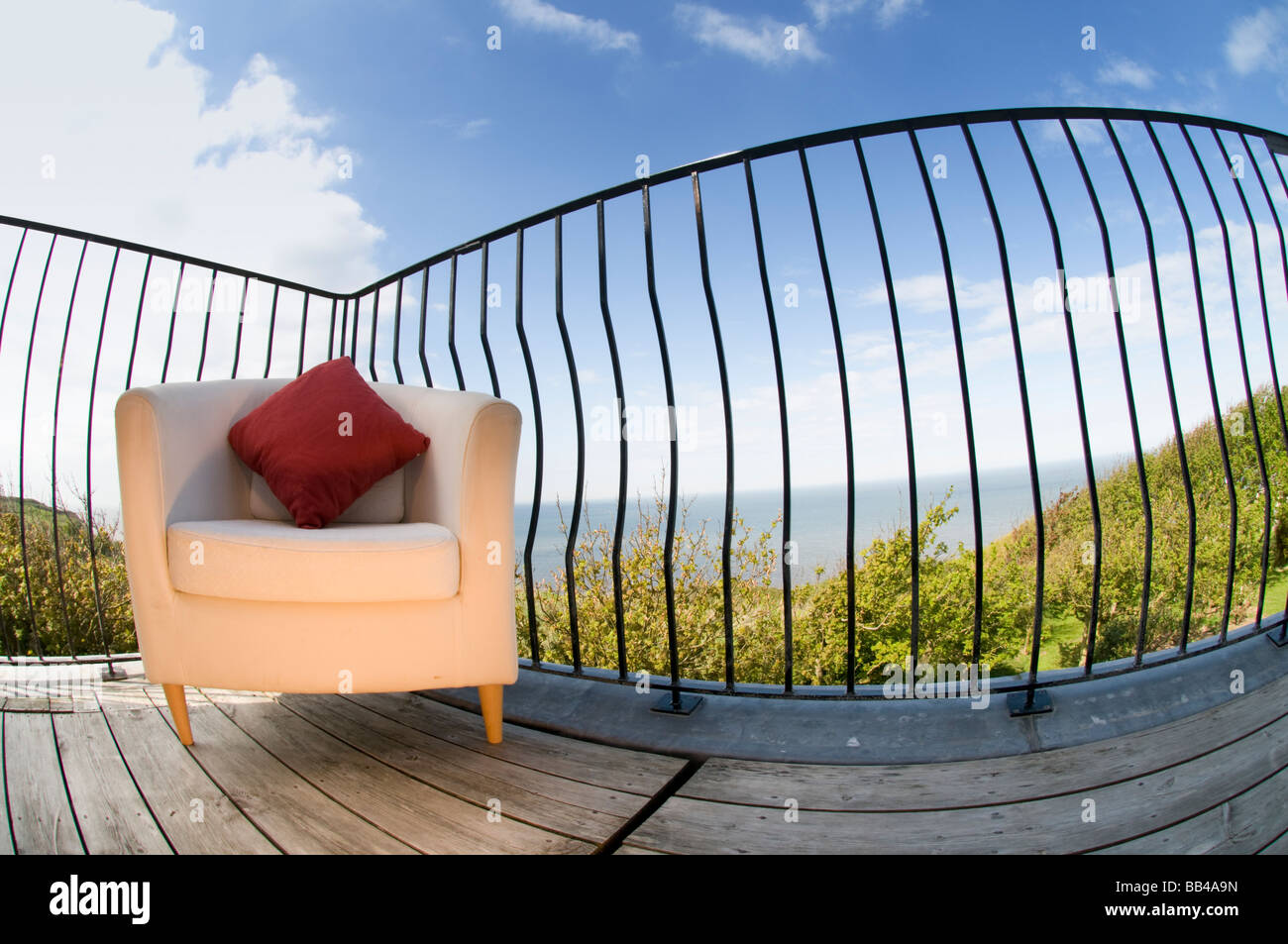 Chair On Balcony looking Out To Sea - Stock Image