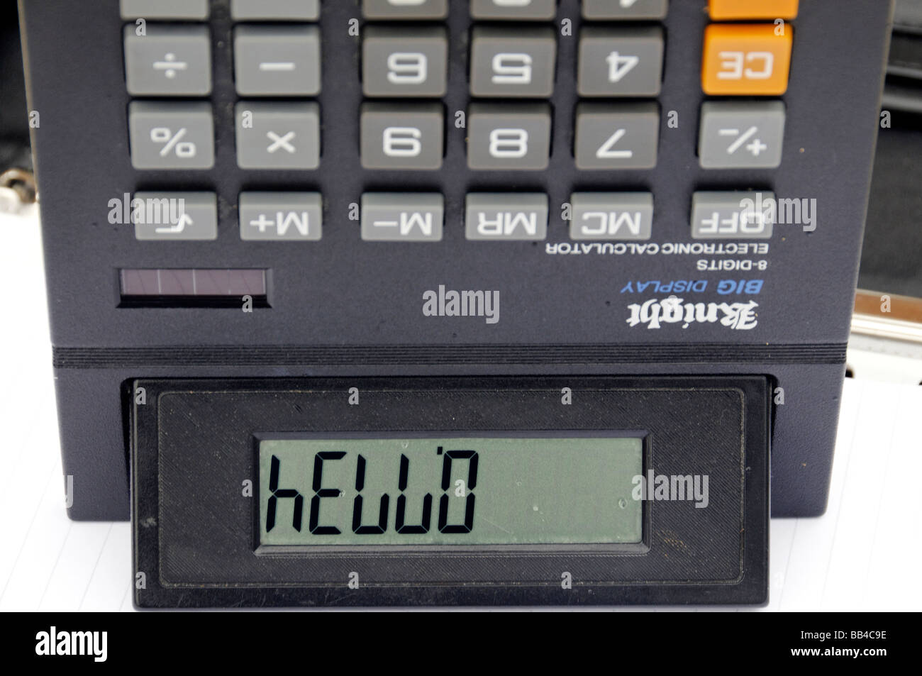 Solar powered calculator upside down showing the word hello. Stock Photo