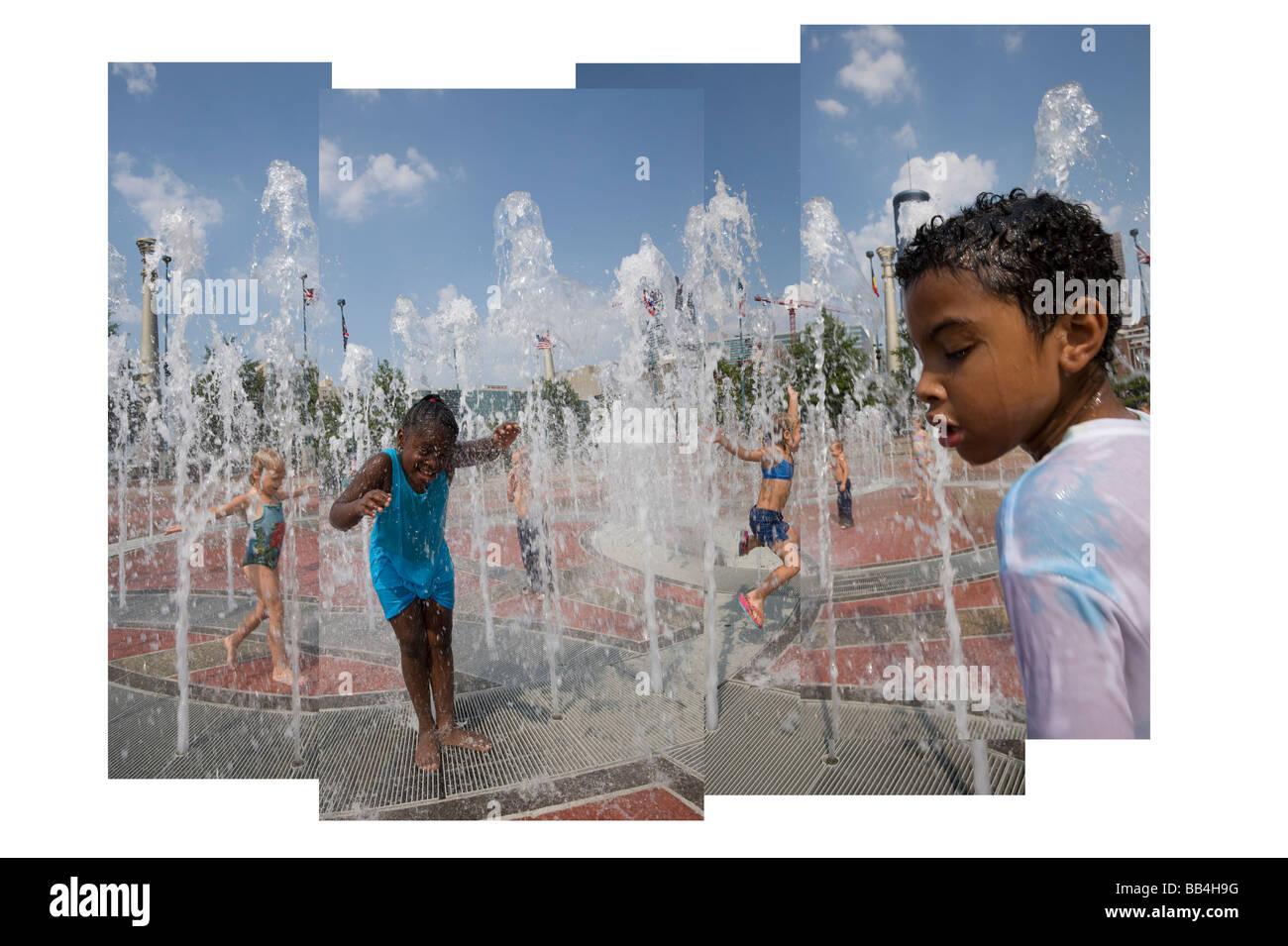 Children play in the Centennial Park Fountain, Atlanta, GA - Stock Image
