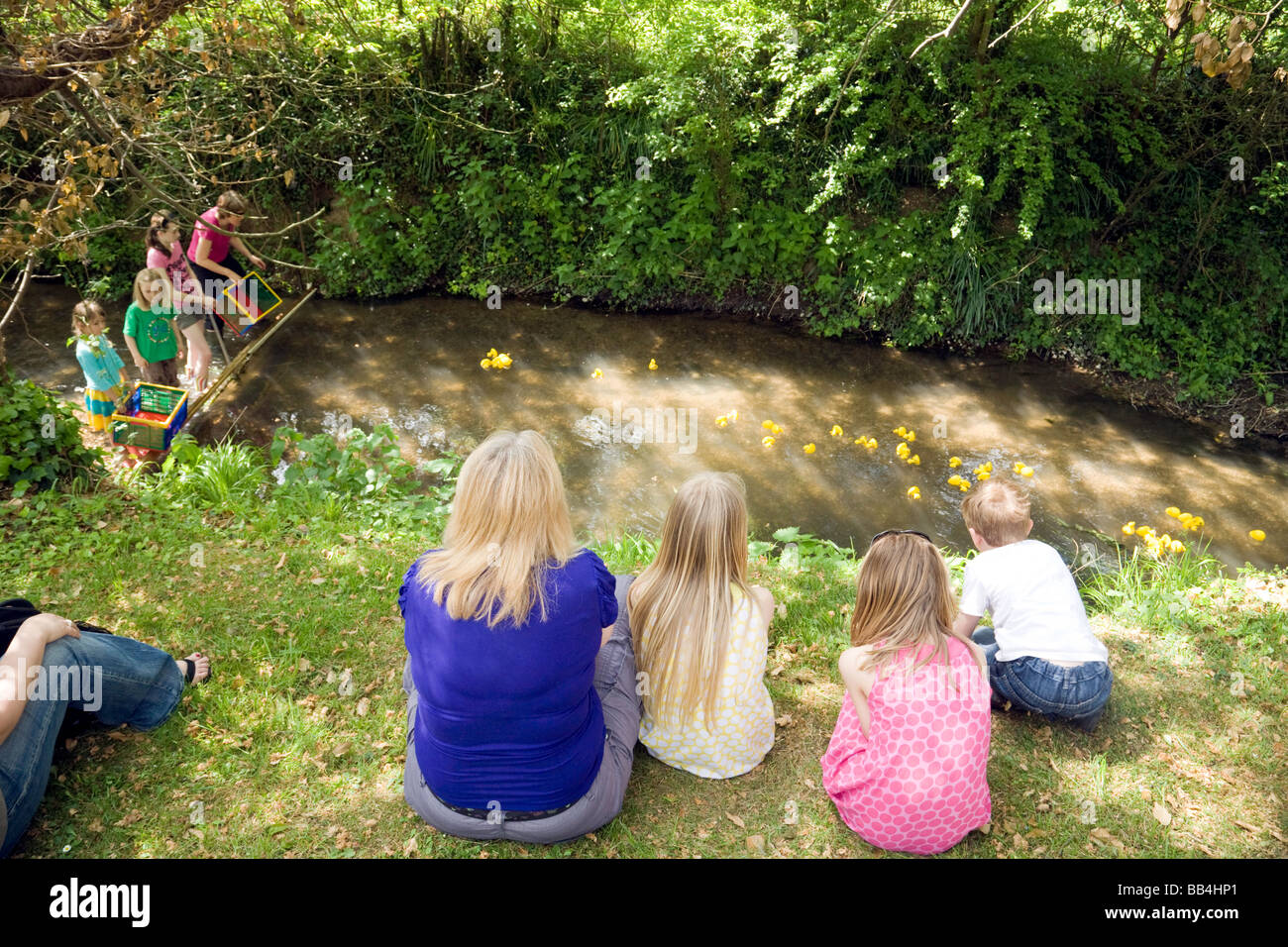 People watching a Charity plastic duck race at Wallingford, Oxfordshire, UK - Stock Image