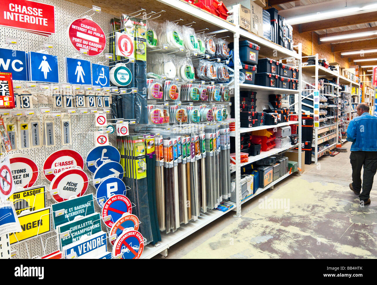 Domestic signs and draft excluder fittings display at 'Bricomarché' D-I-Y store - France. - Stock Image