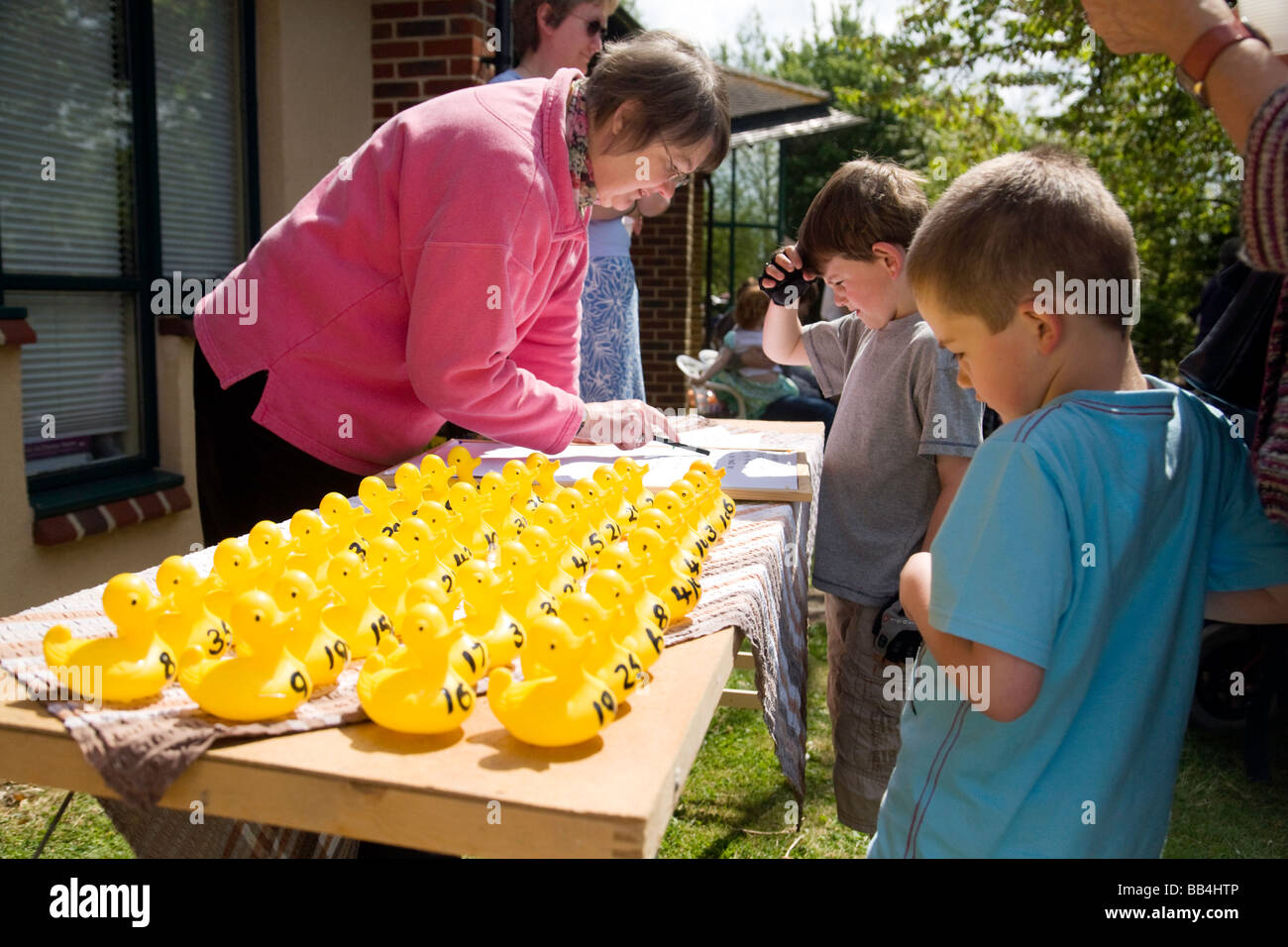 Children view the participants in a Charity plastic duck race at Wallingford, Oxfordshire, UK - Stock Image