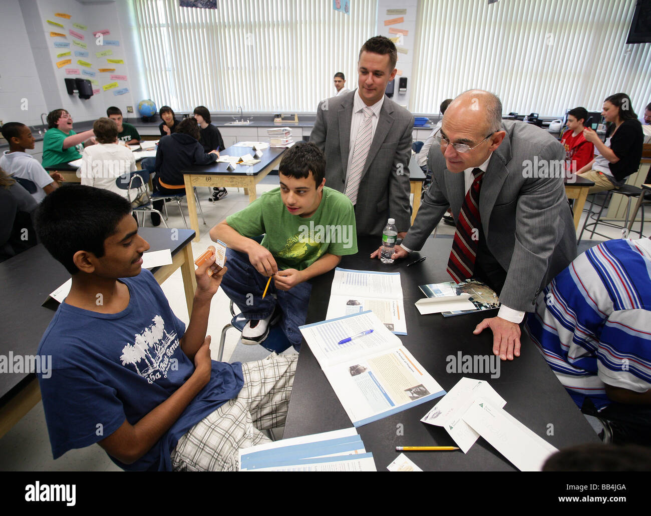 Junior Achievement mentors from local businesses work with High School Students in Milford CT USA - Stock Image