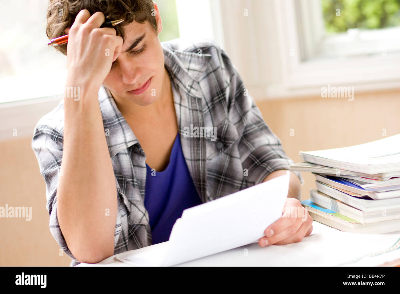 Male student studying - Stock Image