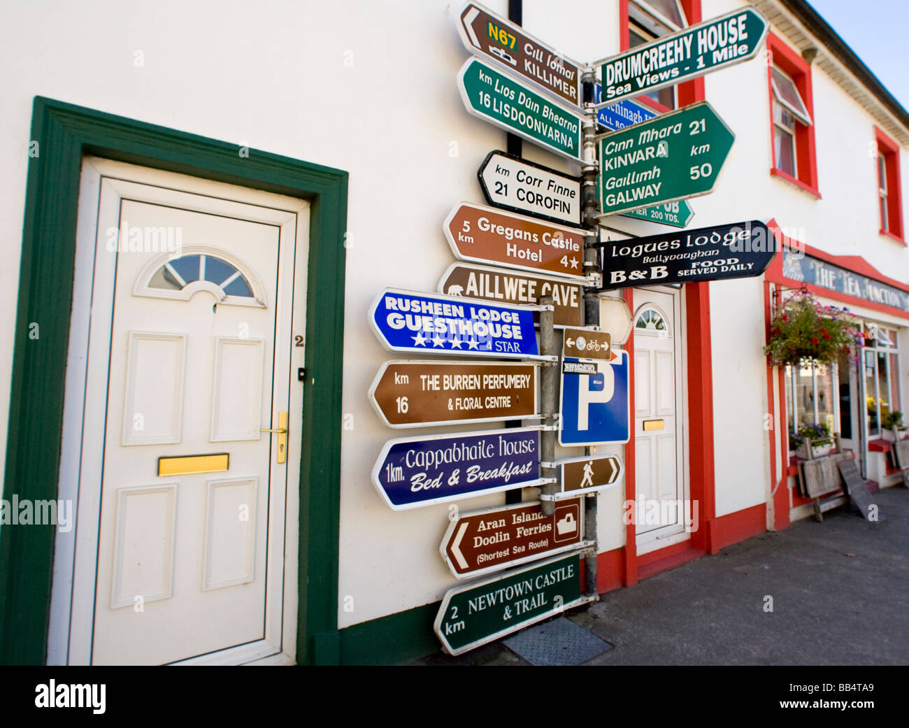 Europe, Ireland, Ballyvaughan. Close-up of informative sign post in the village center. - Stock Image