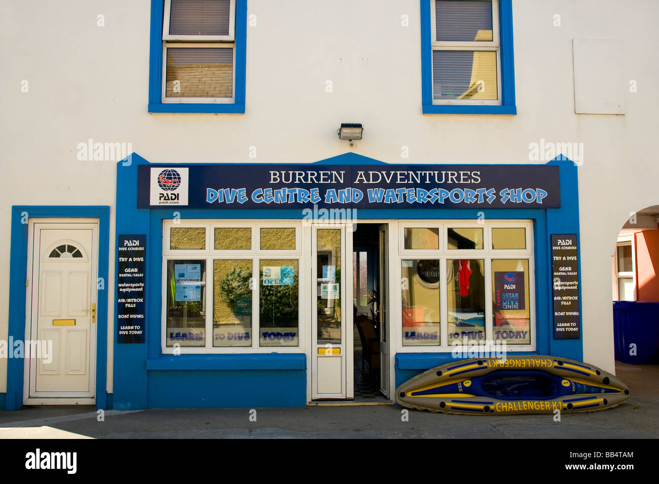 Europe, Ireland, Ballyvaughan. Store front of a dive center and watersports shop in the town center. - Stock Image