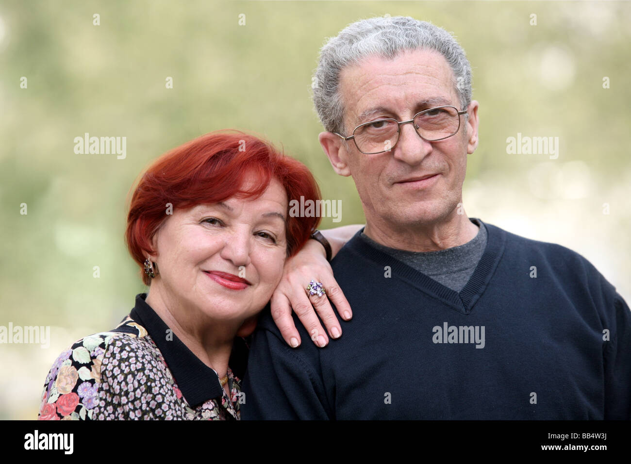 Portrait of a happy couple in their seventies - Stock Image
