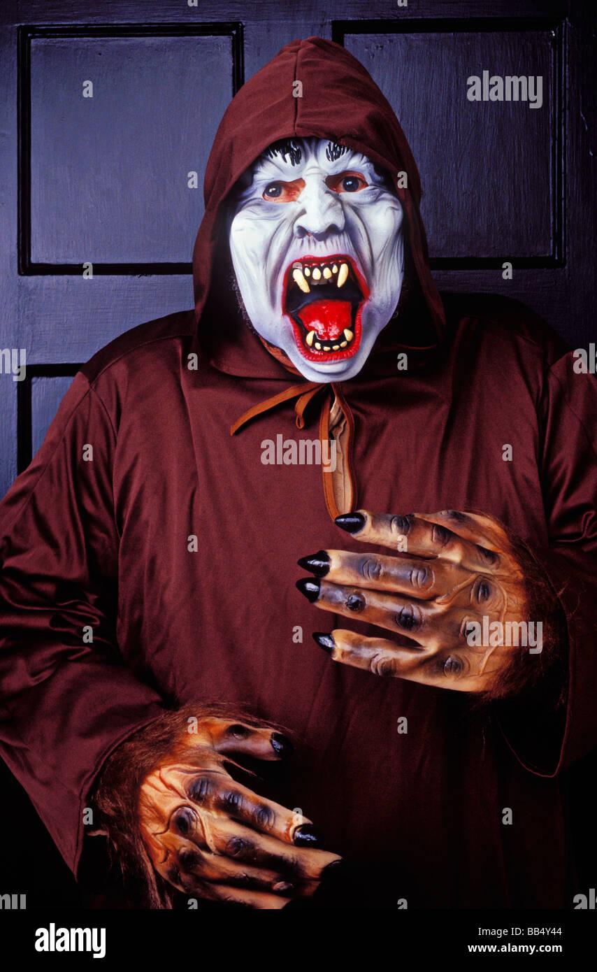 Monster in hooded robe Halloween - Stock Image