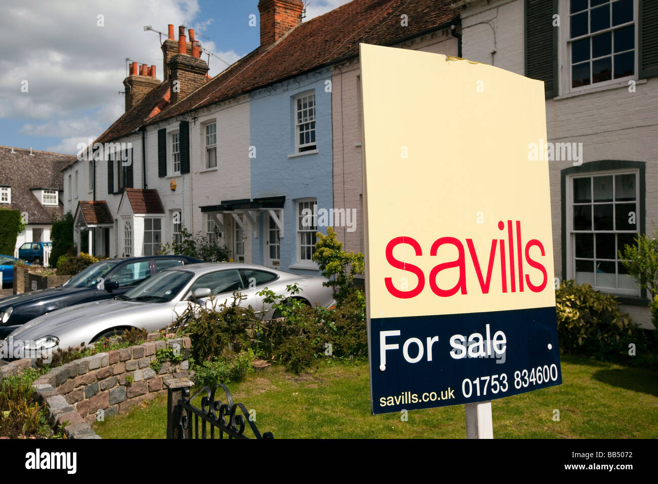 England Berkshire Bray Village Ferry Road Savills estate agents sign outside cottage for sale - Stock Image
