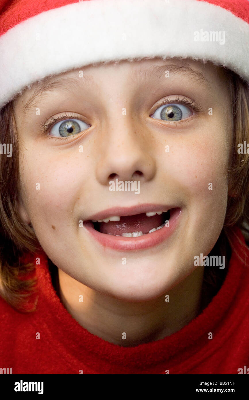 boy missing two front teeth wearing a christmas hat stock image - All I Want For Christmas Is My Two Front Teeth