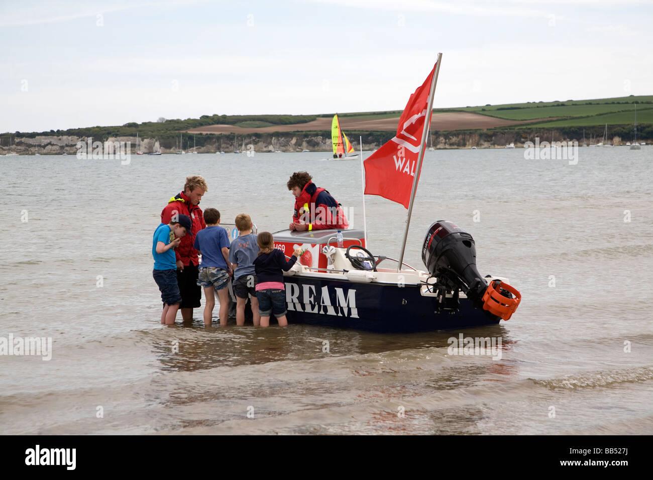 Ice cream boat children buying ice creams - Stock Image
