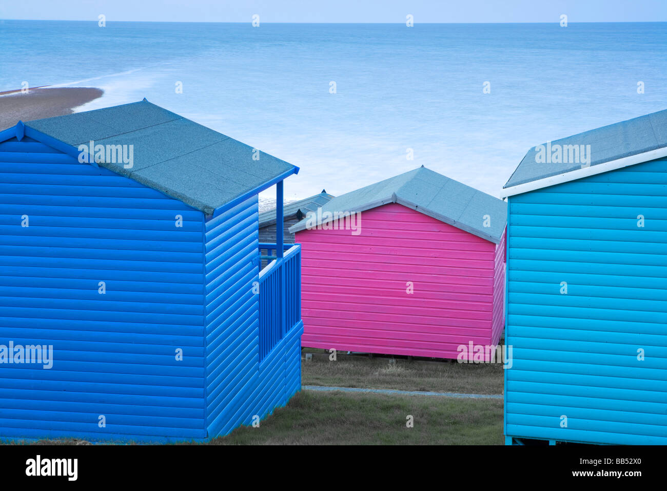 Brightly coloured beach huts, Whitstable Kent Stock Photo