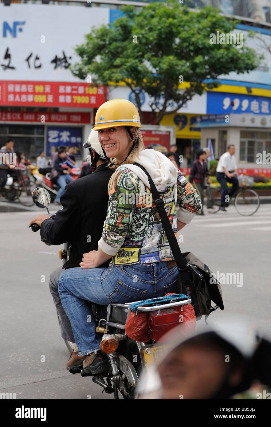 Dutch lady on a motorcycle while travelling in Quanzhou, Fujian, China. 14-Apr-2009 - Stock Image