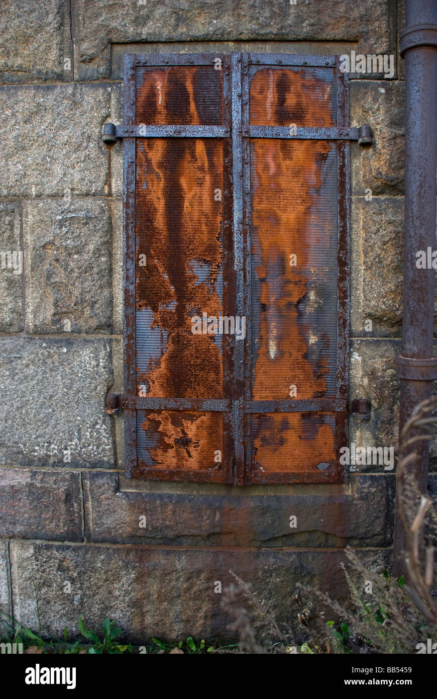 rust rusty iron shutters stone wall antique old ruin