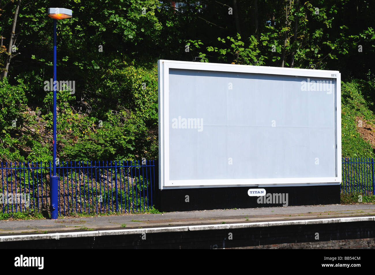 Empty advertising billboard on a station platform - Stock Image