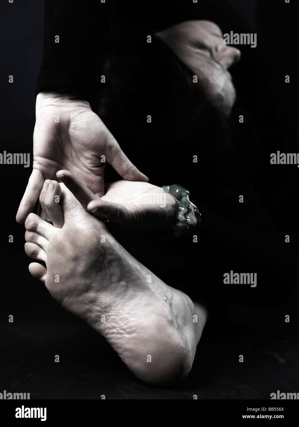 Parivrtta Janu Sirsasana (Revolved Head-to-Knee Pose) yoga detail - Stock Image