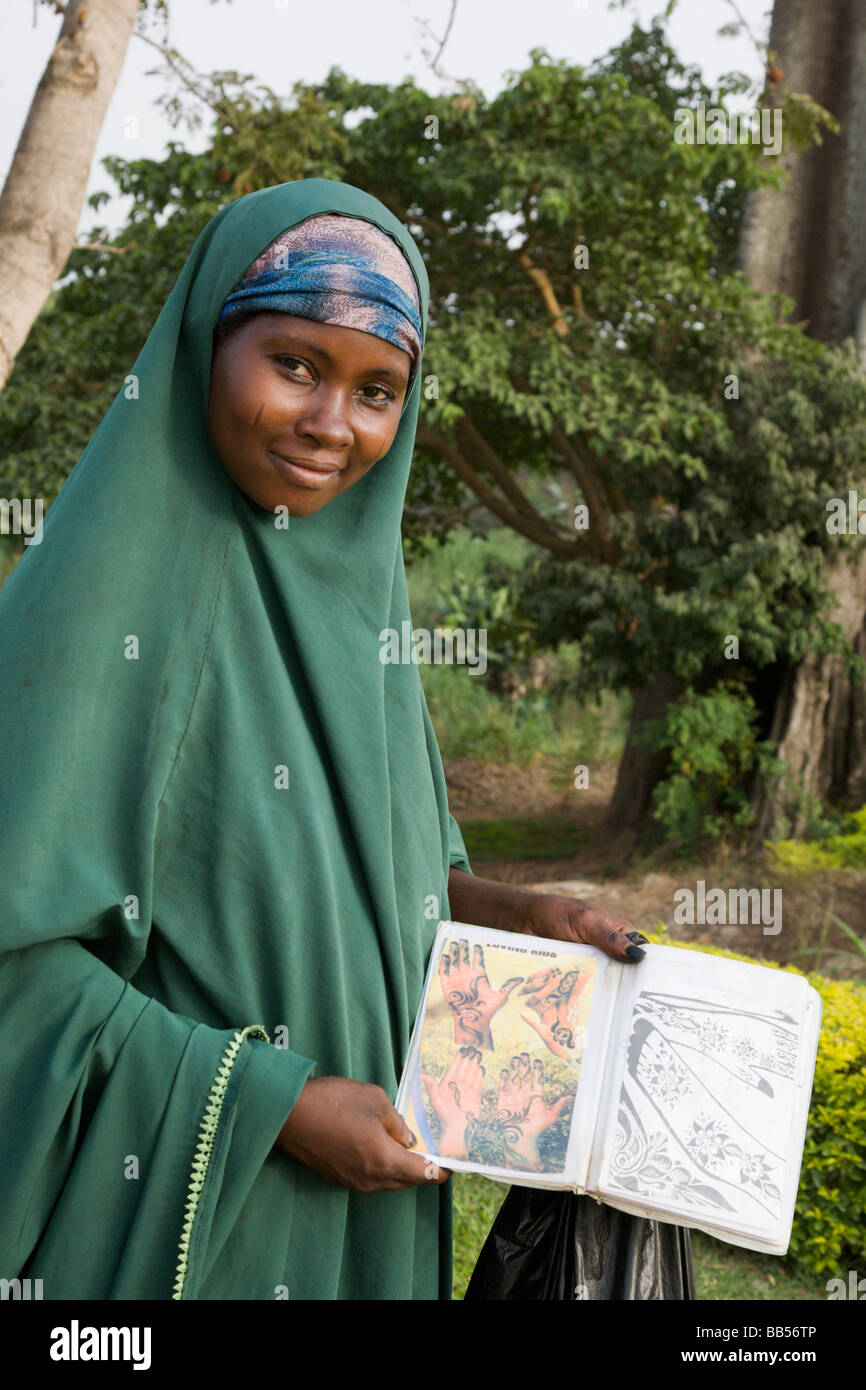 A woman peddles henna services in Abuja's Millenium Park. - Stock Image
