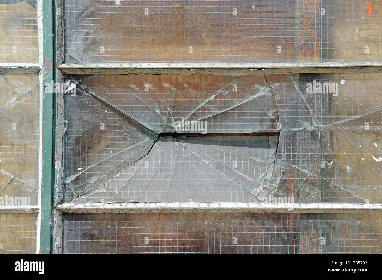 Broken window Hackney England UK - Stock Image
