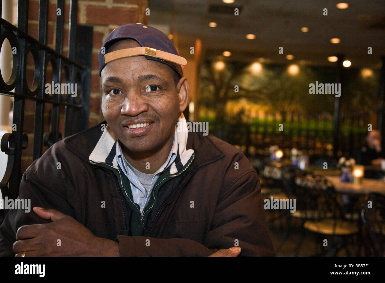 A tourist samples Seasons Restaurant in Merchant Square next to Colonial Williamsburg, Virginia. - Stock Image