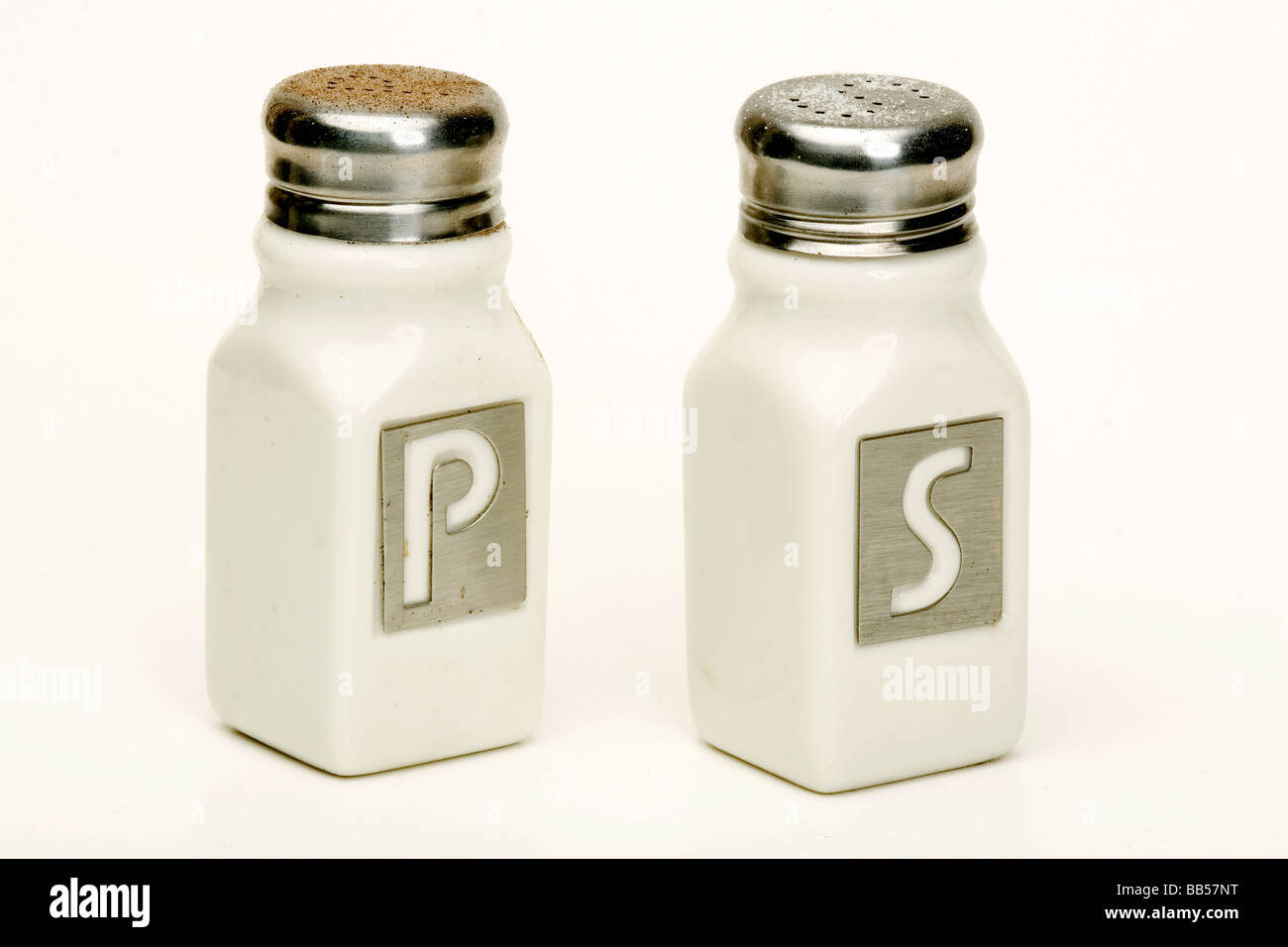 Salt and pepper shakers on white background - Stock Image