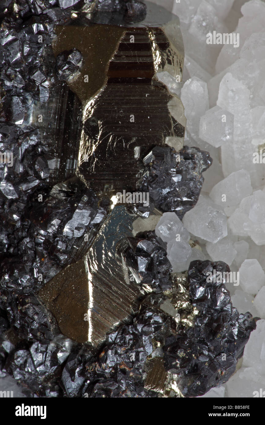 Sphalerite (dark color) Pyrite (golden color) and Quartz (white color) Crystals  - Peru - Stock Image