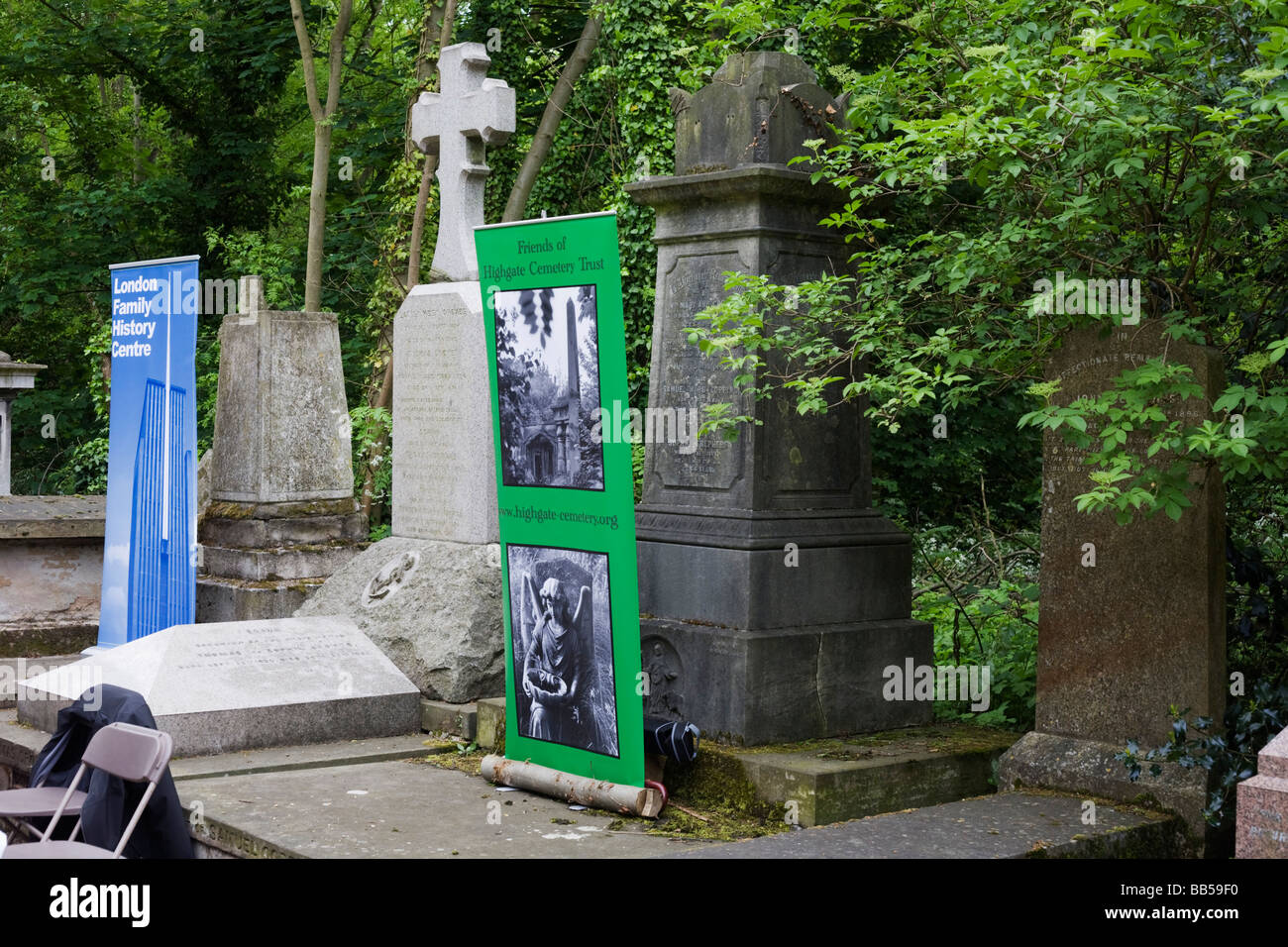 A genealogy society has a stall next to tombs and memorials during Nunhead Cemetery's open day - Stock Image