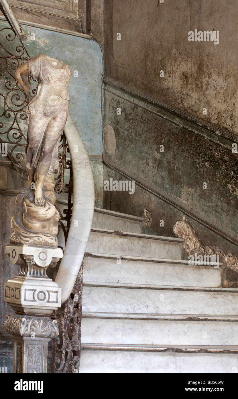 Ornate marble staircase to La Guarida Paladar Restaurant and statue in apartment building at Havana, Cuba, West Stock Photo