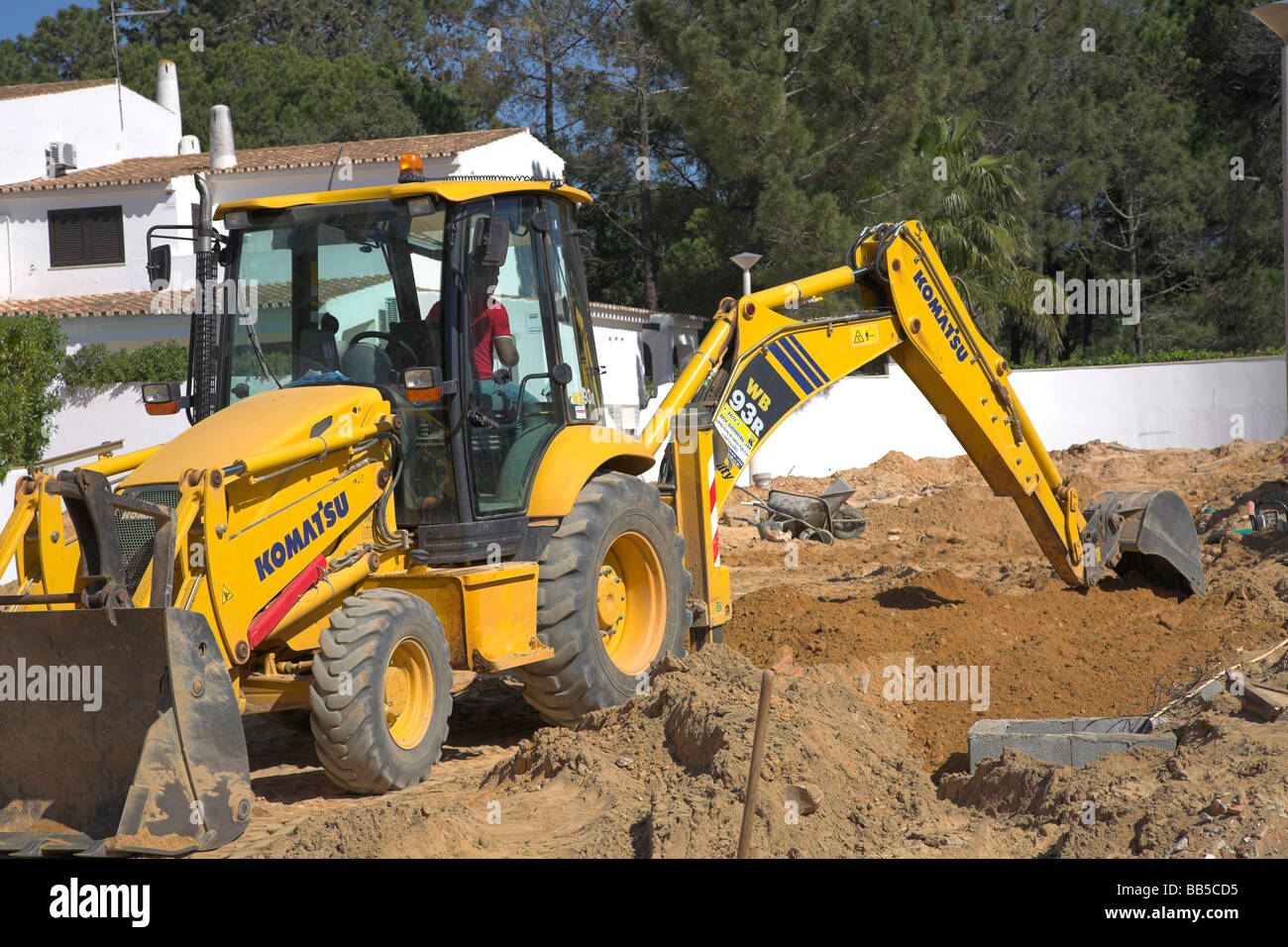 Digger preparing trench Stock Photo